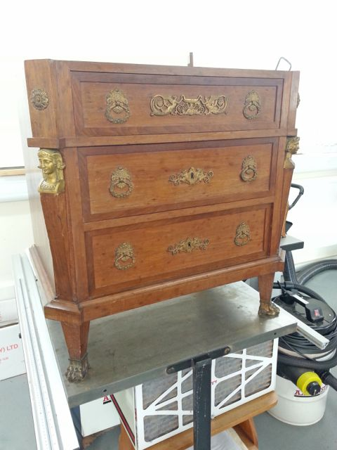 Empire style chest of drawers with gilt mounts