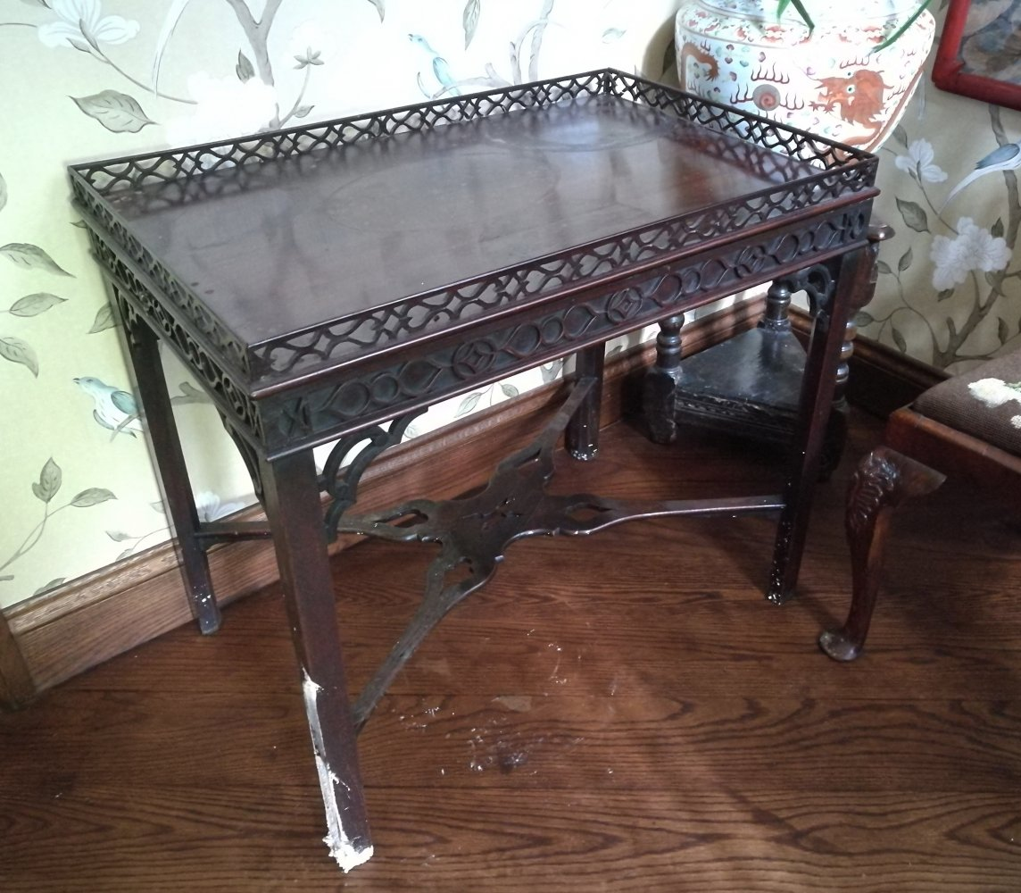 Water damaged table with fretwork gallery