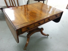 Rosewood sofa table with brass inlay