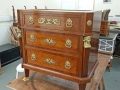 Chest of drawers re-finished and with the mounts cleaned