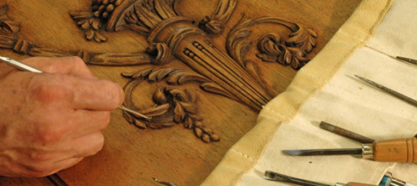 Restored fine wooden detailing on antique furniture